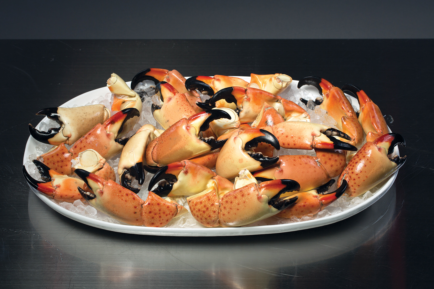 A very large platter of Fresh Florida Stone Crab Claws on ice