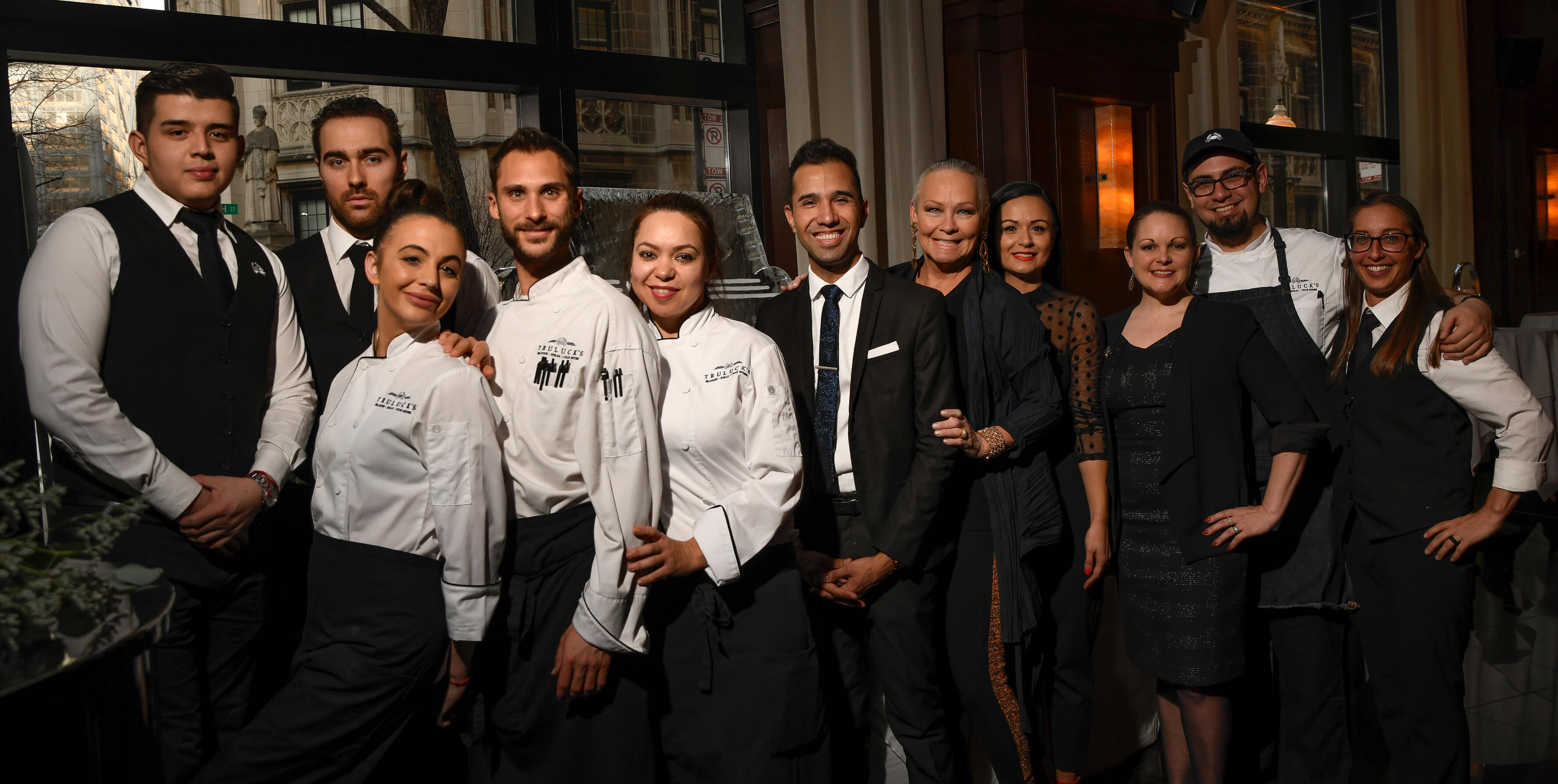 picture of Our kitchen and front of house staff, smiling confidently together