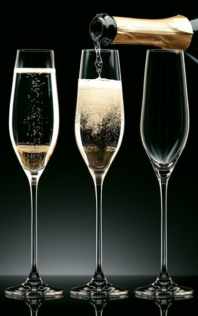 picture of Three champagne glasses being filled up