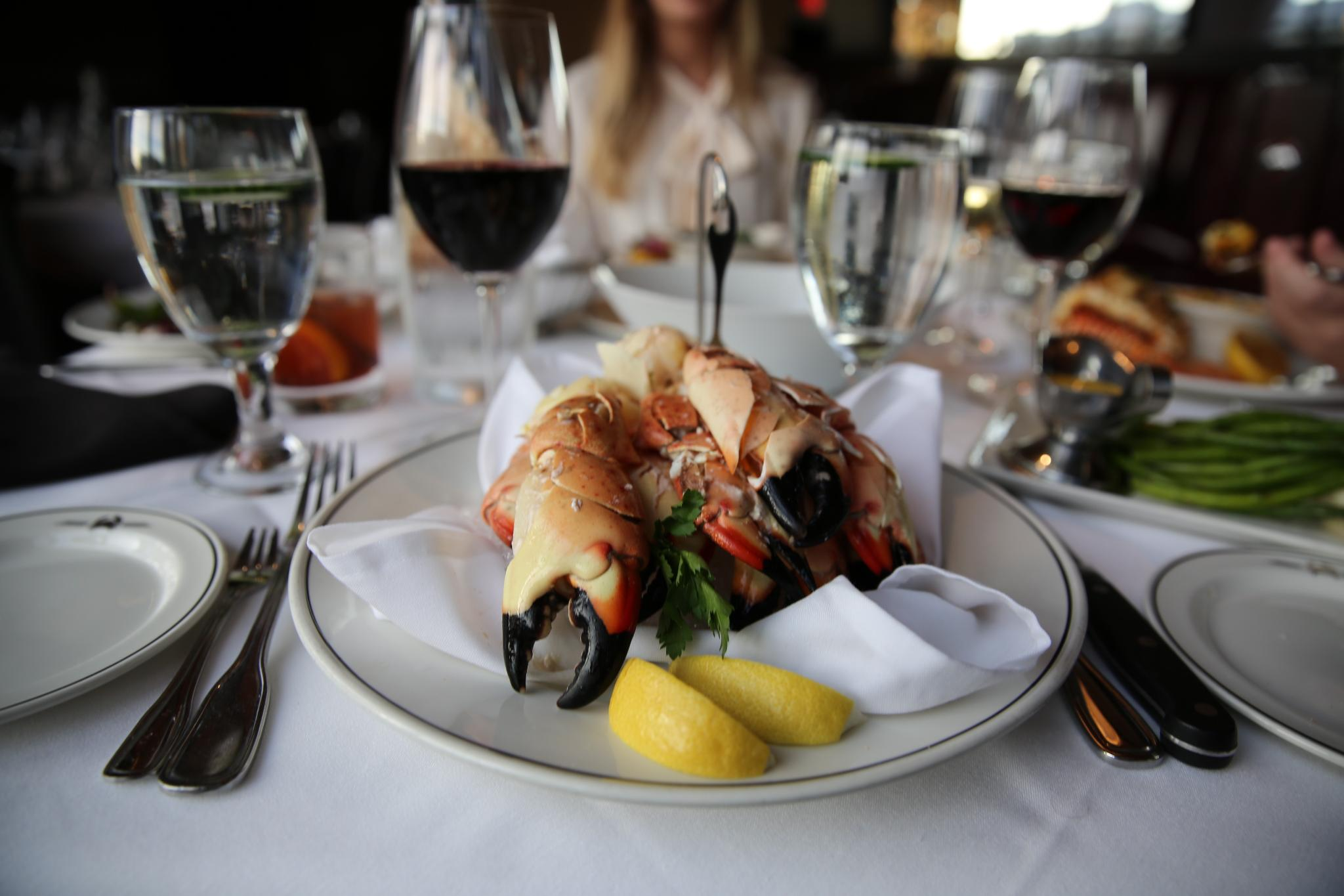 A plate of Florida Stone Crab claws as part of an elegantly set table