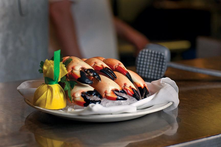 Florida Stone Crab claws on a plate, being served