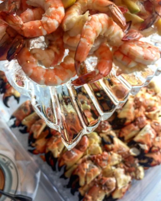 picture of Dallas private event with a chilled seafood display to include shrimp cocktail and fresh crab claws