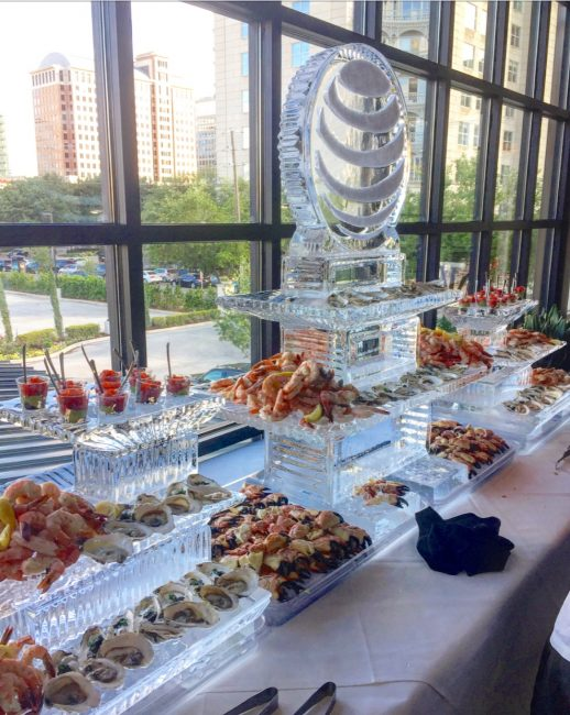 picture of Dallas private event with ice sculpture and chilled seafood display to include ahi tuna, oyster, shrimp cocktail and fresh crab claws