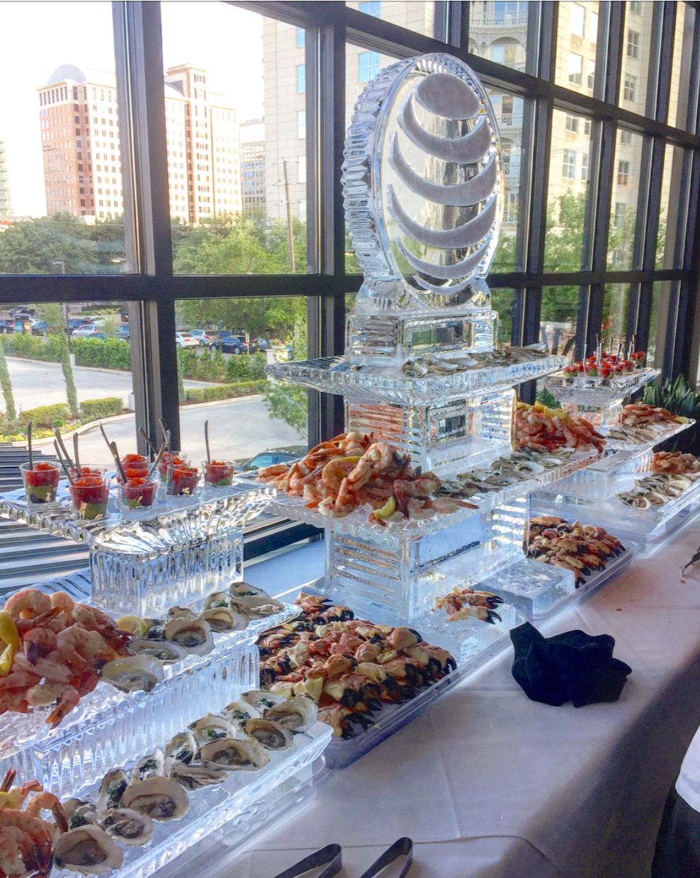 Dallas private event with ice sculpture and chilled seafood display to include ahi tuna, oyster, shrimp cocktail and fresh crab claws