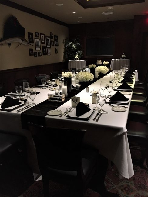 picture of Dallas private dining room decorated with white tulips and white hydrangea