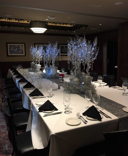 picture of Dallas private dining room decorated with silver holiday decorations