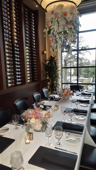 picture of Dallas Big Deal Room decorated for an event with orange, white and lavender floral