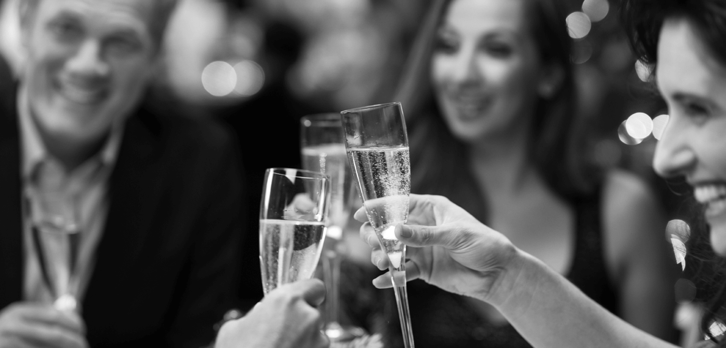 Hands toasting glasses of champagne