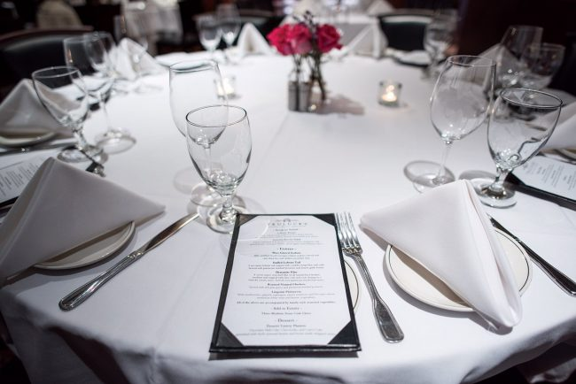 picture of Truluck's private dining table setup with place settings
