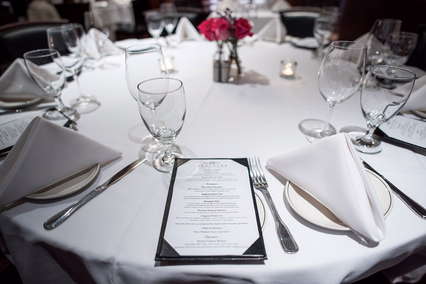 Truluck's private dining table setup with place settings