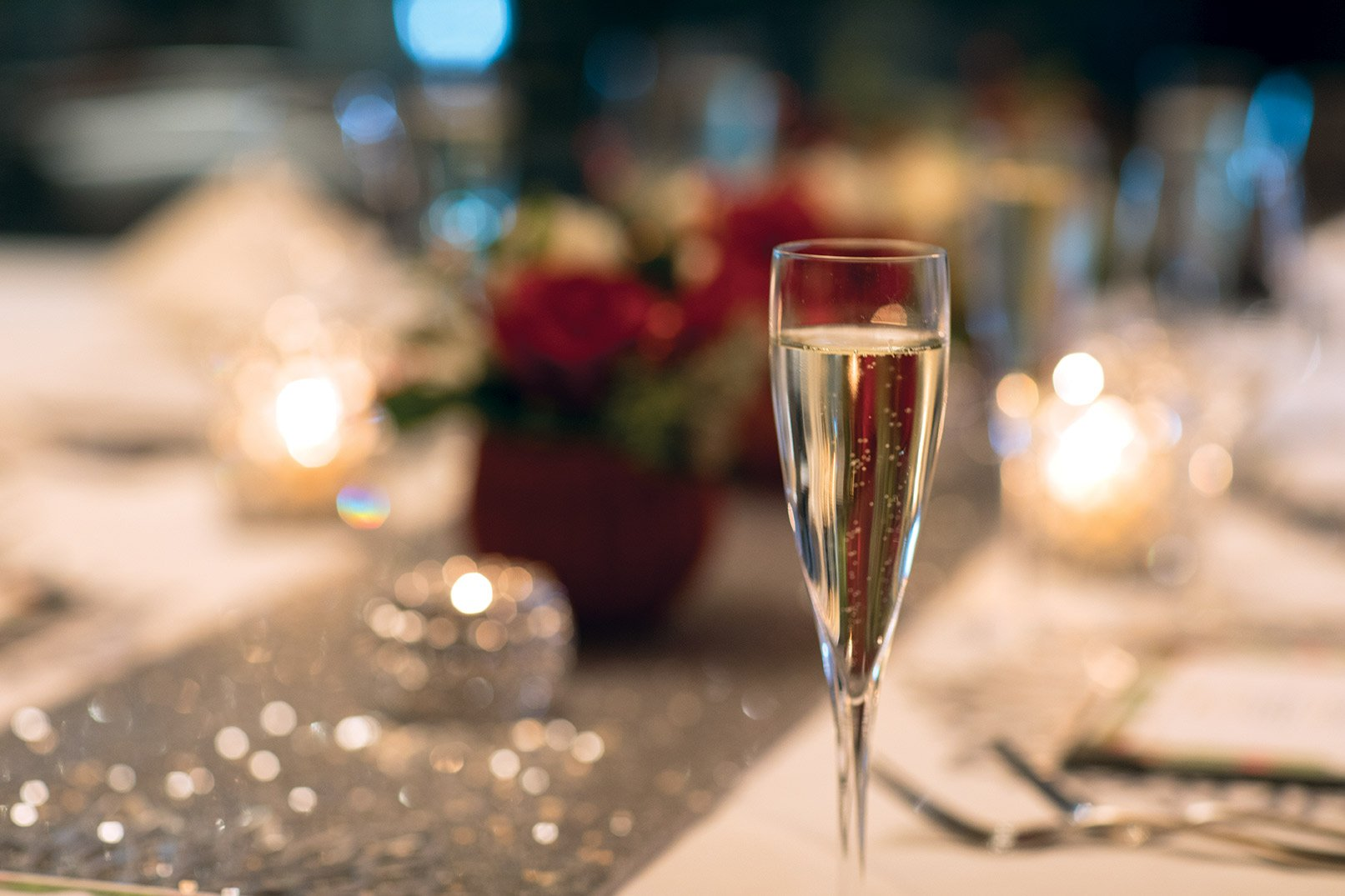 champagne flute in front of private dining holiday table