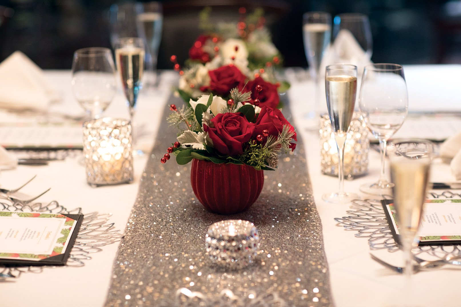 private dining holiday floral centerpiece with red and white roses and holiday greenery
