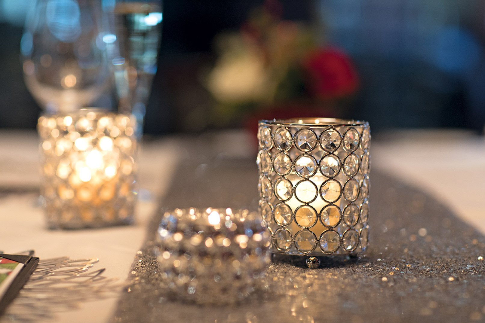 Private dining holiday decorations - crystal candles with a silver table runner