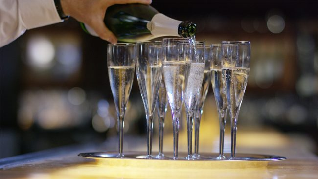 picture of Champagne glasses being filled for a celebration