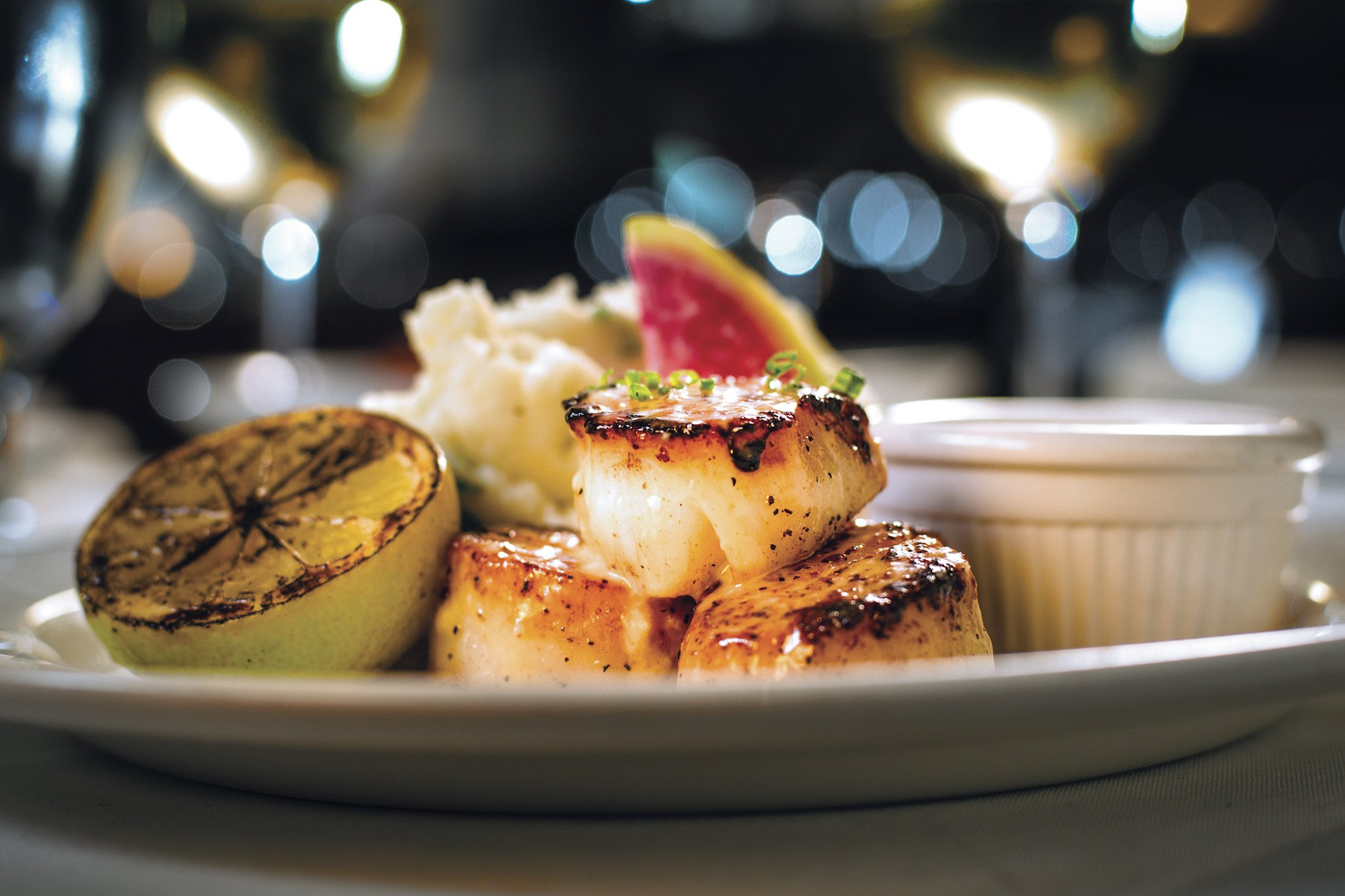 Pan-seared scallops, served with a fresh lemon and parmesan mashed potatoes