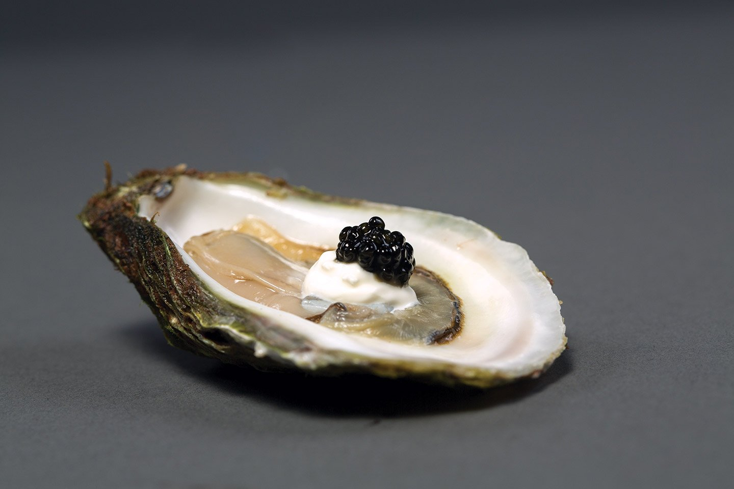 Oyster with caviar and creme fraiche - Oyster with pearls