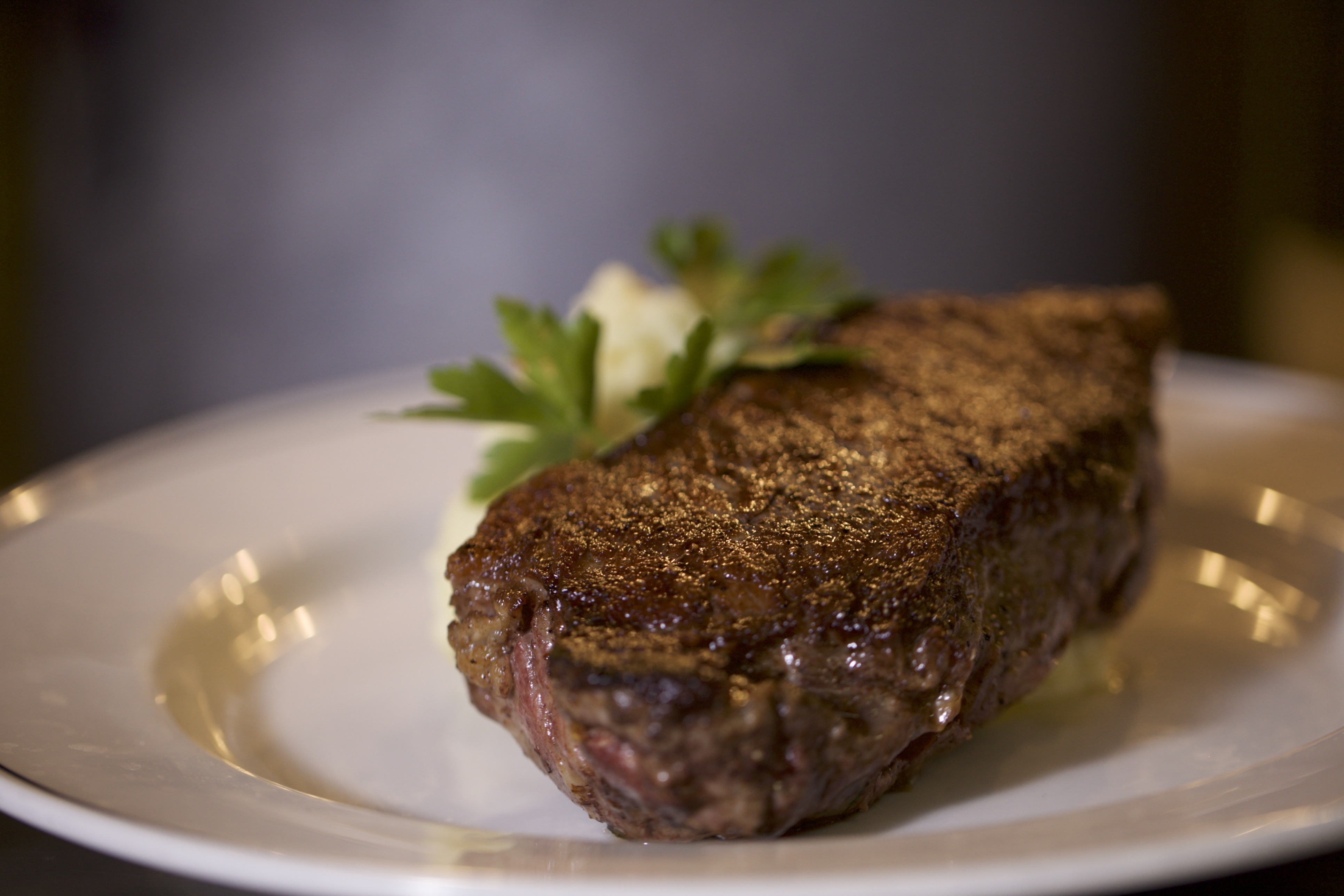picture of New York Strip Steak garnished with parsley
