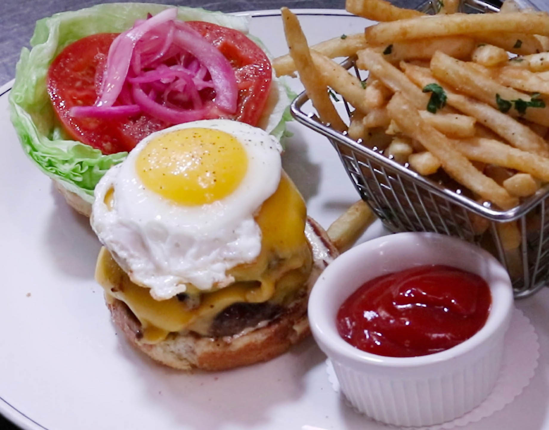 FARMHOUSE BURGER* smashed beef patty topped with American cheese, smoked bacon, pickled onion, fried egg