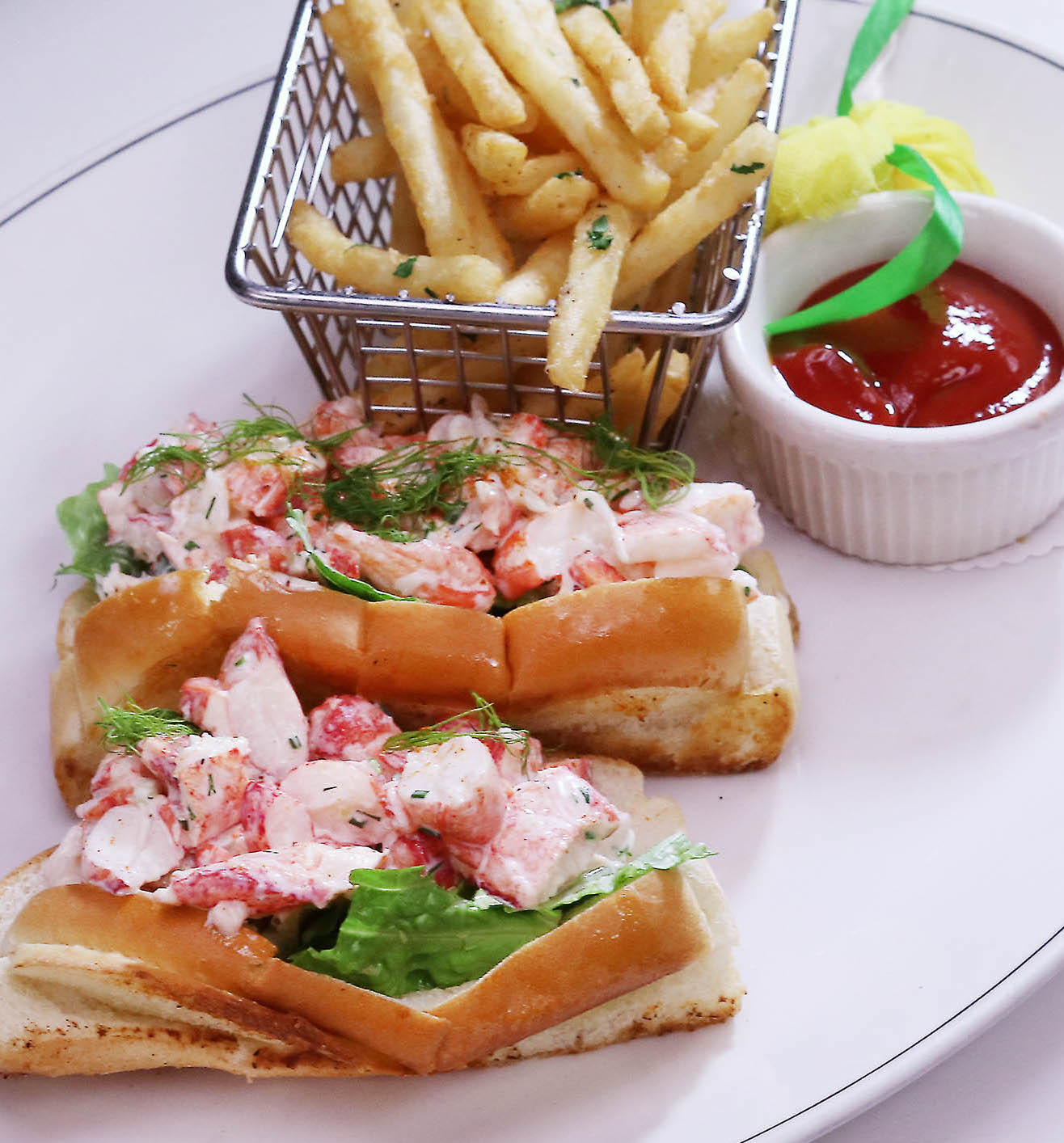 picture of Lobster Roll with French Fries and a side of ketchup