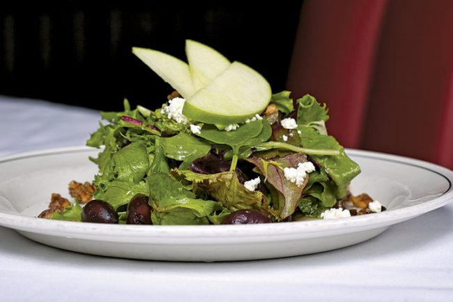 picture of SONOMA GREENS SALAD spicy pecans, goat cheese, apples, kalamata olives, honey vinaigrette