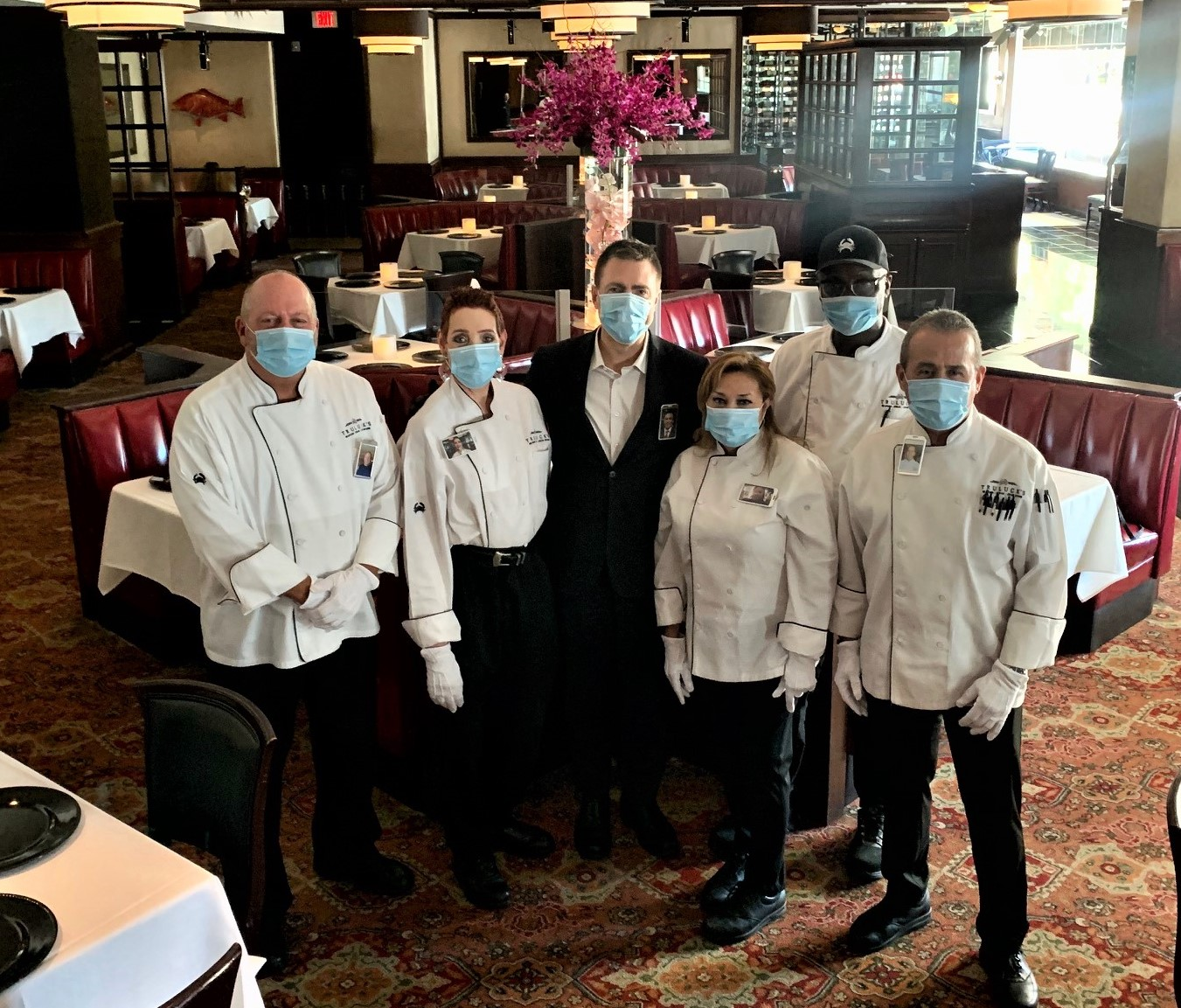 picture of Truluck's Houston staff pictured in masks and gloves during COVID-19. They are ready to offer safe, white glove service to our guests.