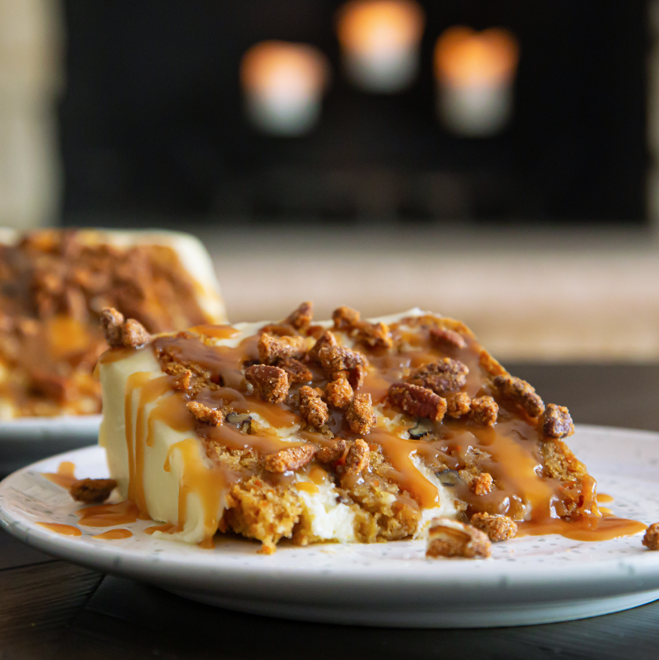 picture of Slice of Carrot Cake on a plate by the fireside after being picked up curbside.