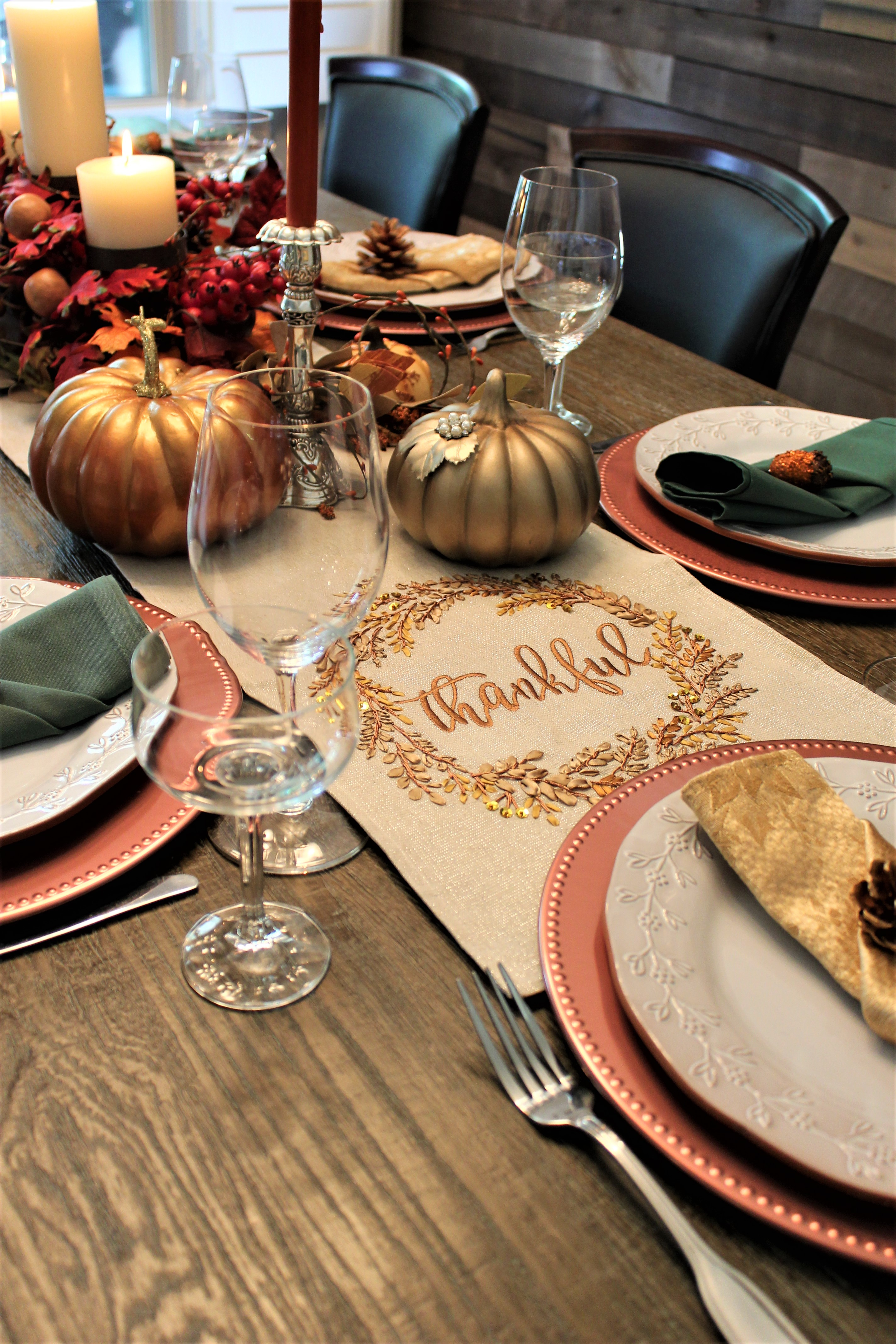 Thanksgiving Celebration Table with place settings, wine glasses, and candles.