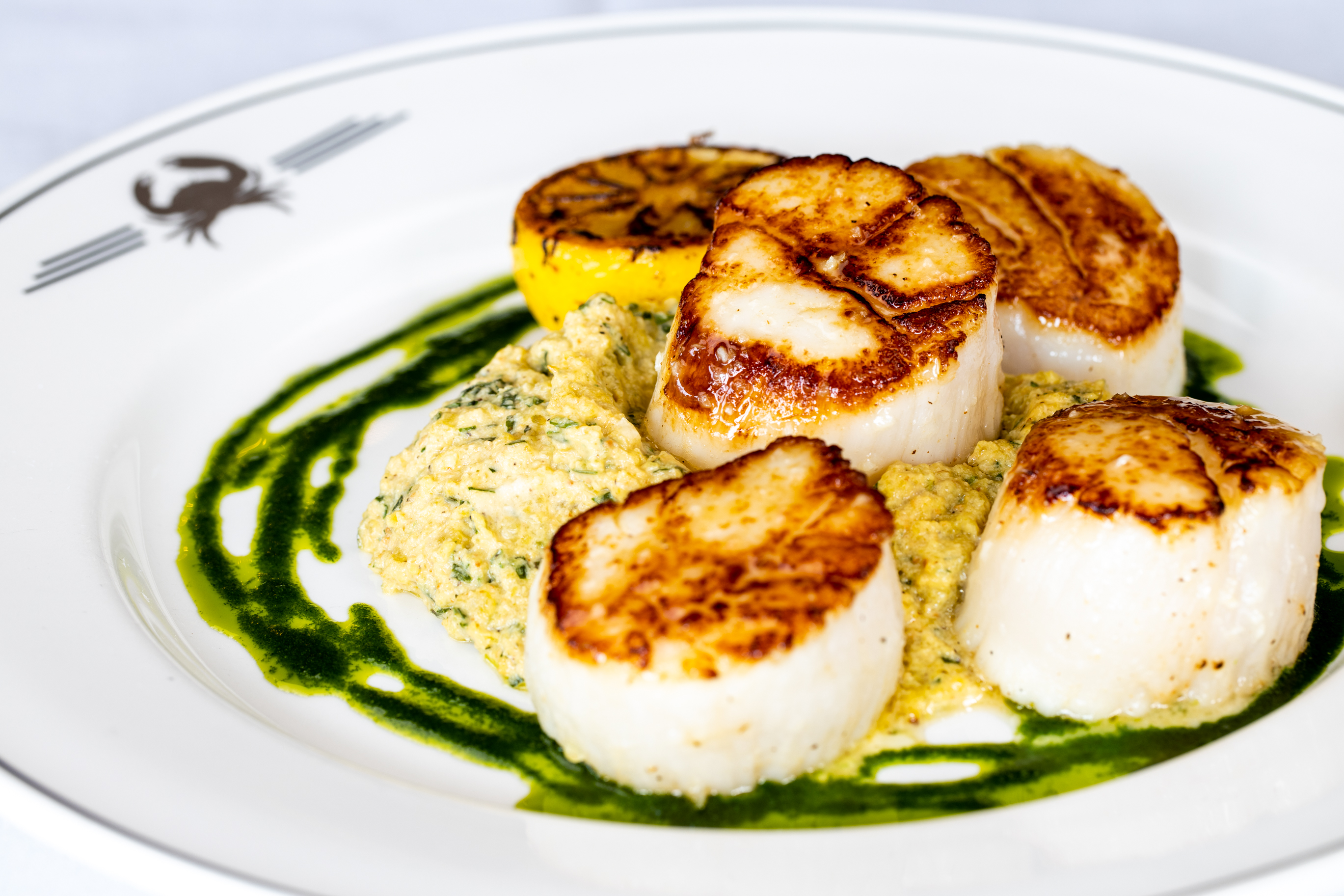 picture of NEW ENGLAND PAN-SEARED SCALLOPS colossal size, with golden beet pesto and herb oil