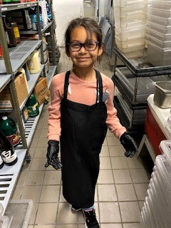 Chef Manuel Vera's daughter in her Chef outfit