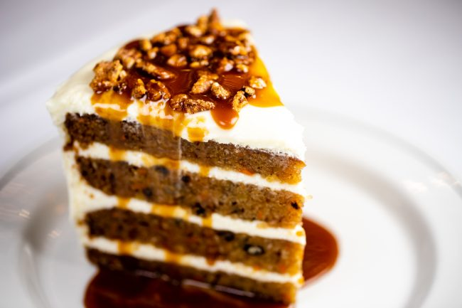 picture of Carrot Cake drizzled with butterscotch sauce and topped with spiced pecans