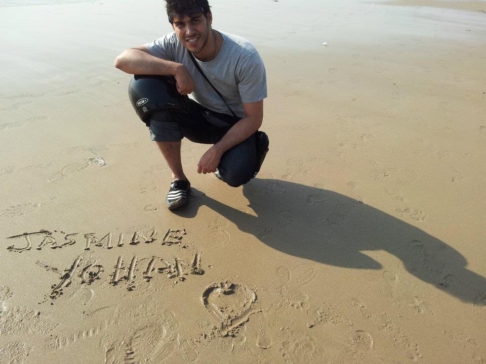 Yohan Vajifdar sending Jasmine a message in the sand