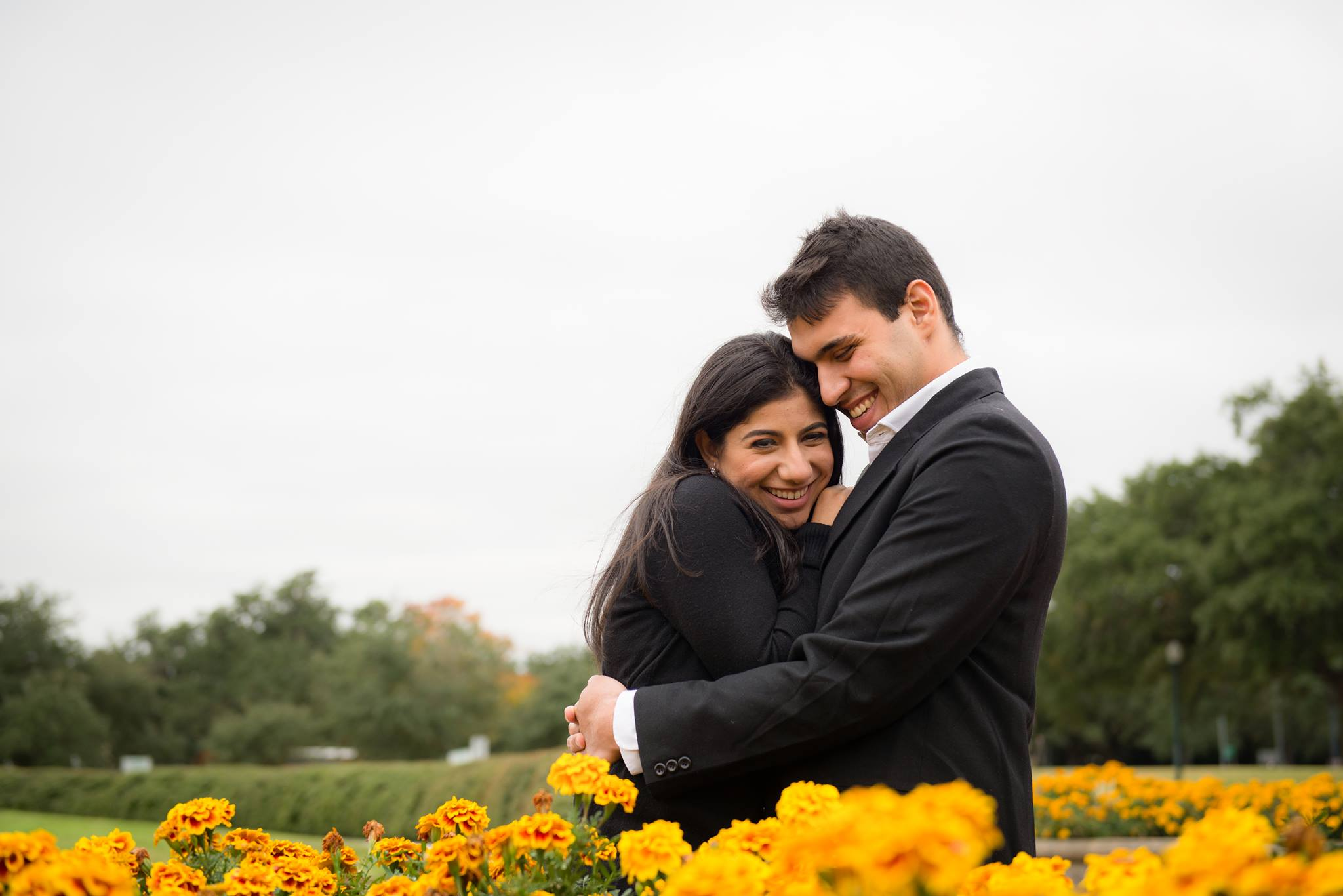 Yohan and Jasmine Vajifdar in a field of marigold flowers when they first became engaged