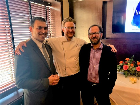 Yohan Vajifdar with Truluck's event captain and a wine sommelier for a charity wine dinner