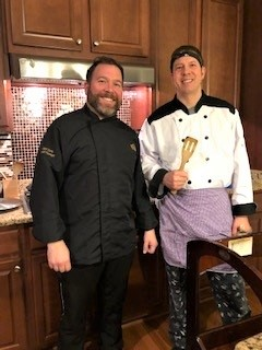 picture of Bond Davis with a server teammate at an in home dining event