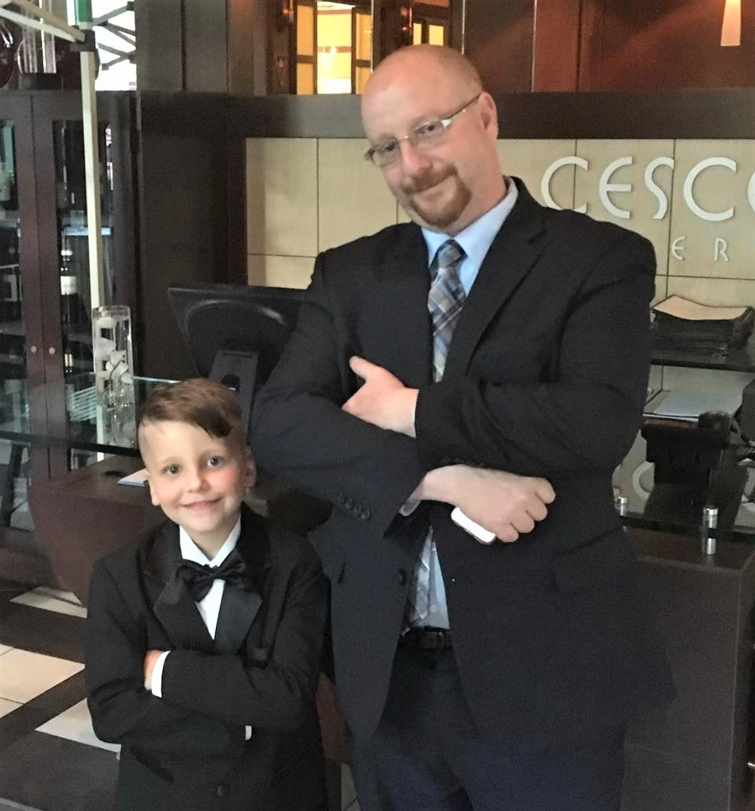 picture of Chef Laurence Cohen and his son dressed up in suit and tie