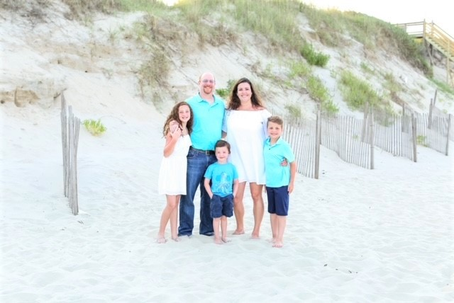 picture of Chef Laurence Cohen with his family on the beach