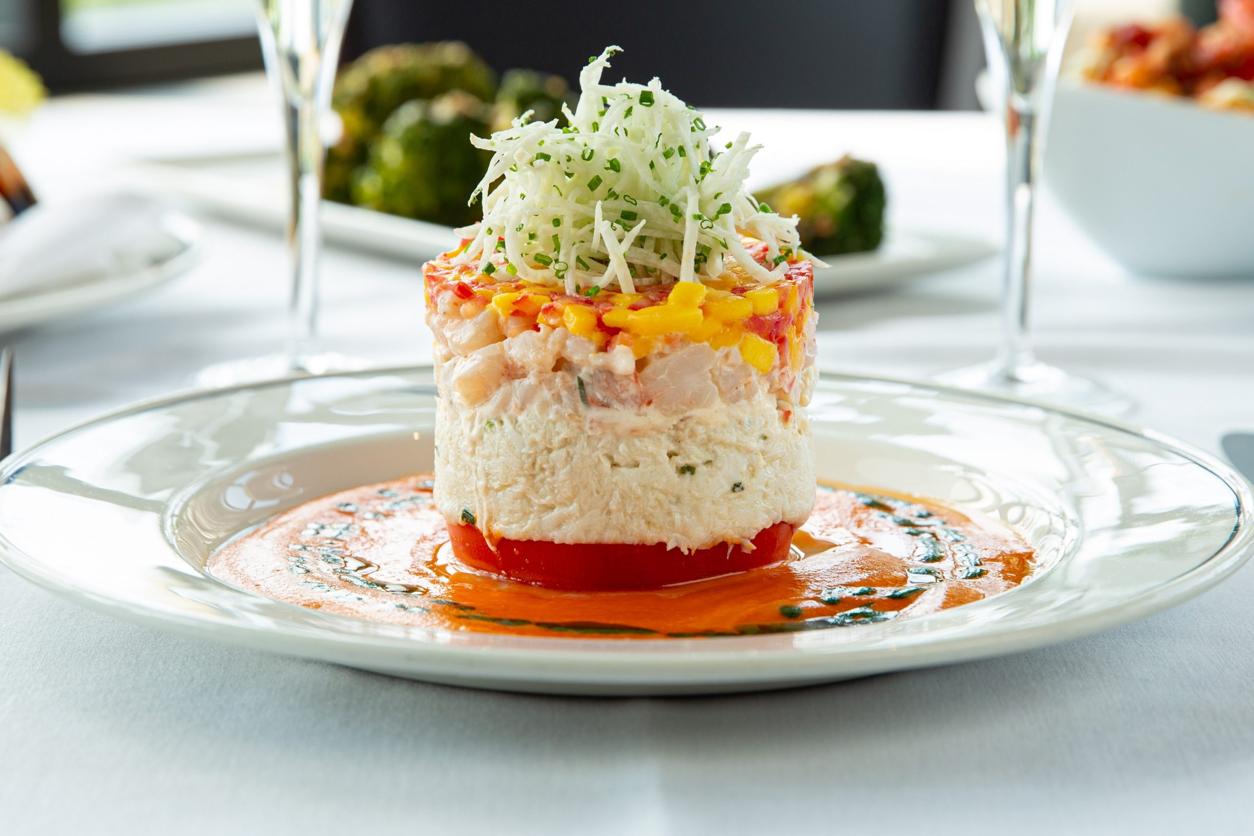 picture of the crab and shrimp Napoleon on a plate on a dining table