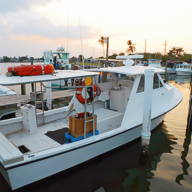 picture of stone crab fishing boat docked in the water