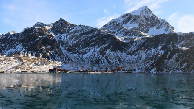 picture of fishing town below artic mountains