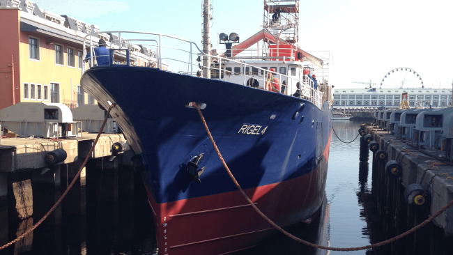 picture of a lobster fishing boat in the dock named RIGEL 4