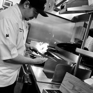picture of Chef Michael Cerny in the kitchen holding a Chef's knife